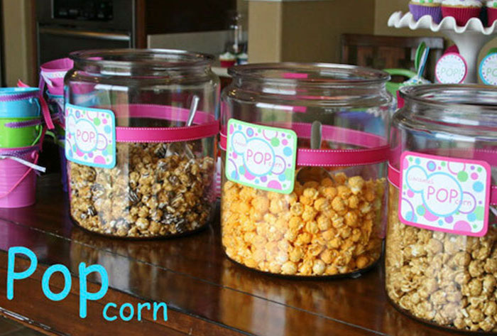 glass jars, full of popcorn, ready to pop, pink and gold baby shower, wooden table