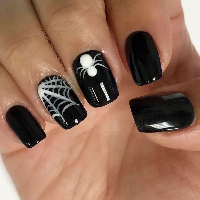 black nail polish, october nails, white spider webs, spider decorations, short squoval nails