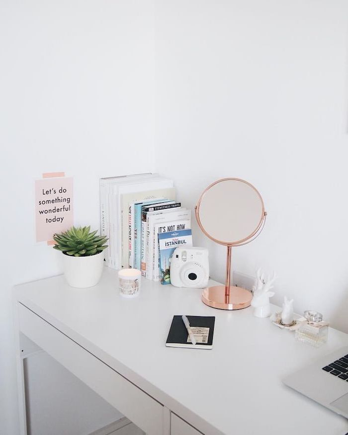 cool office decor, white desk, rose gold mirror, potted succulent, polaroid camera, white wall