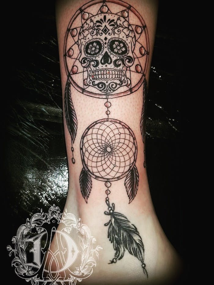 skull inside a dreamcatcher, dream catcher tattoo on arm, leg tattoo, black background, best friend dream catcher tattoo