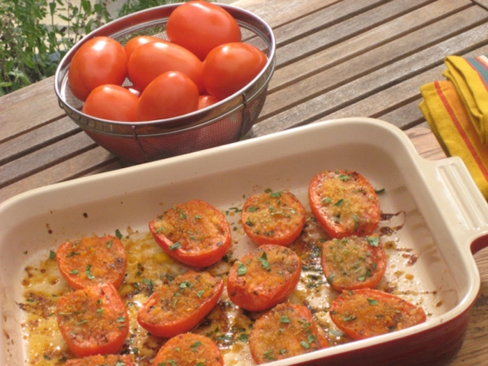 brunch recipe ideas, baked halved tomatoes, white casserole, wooden table, tomatoes in a bowl