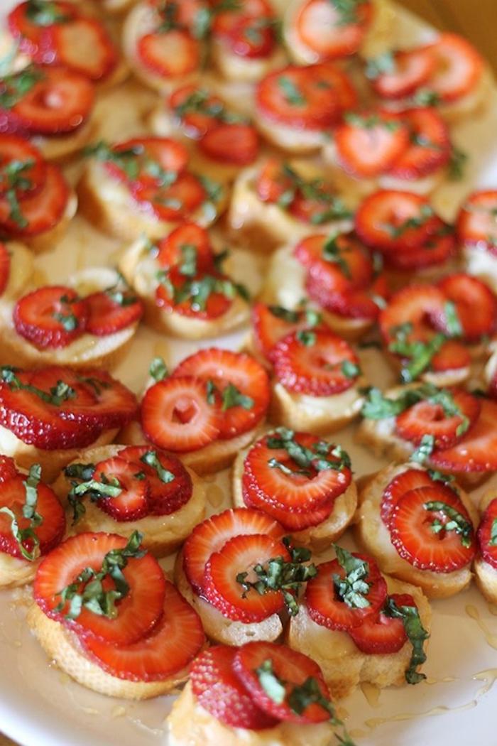 bruschetta bites, with strawberry slices on top, brunch recipe ideas, white plate