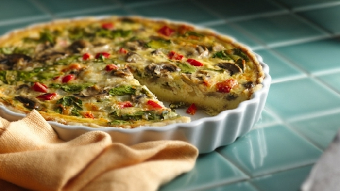 baked casserole, eggs with spinach and mushrooms, fancy breakfast, blue tiled countertop