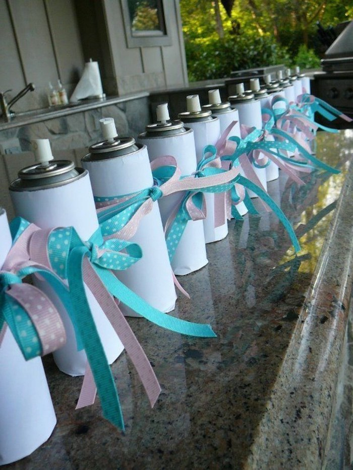 white spray cans, unique gender reveal party ideas, pink and blue ribbons