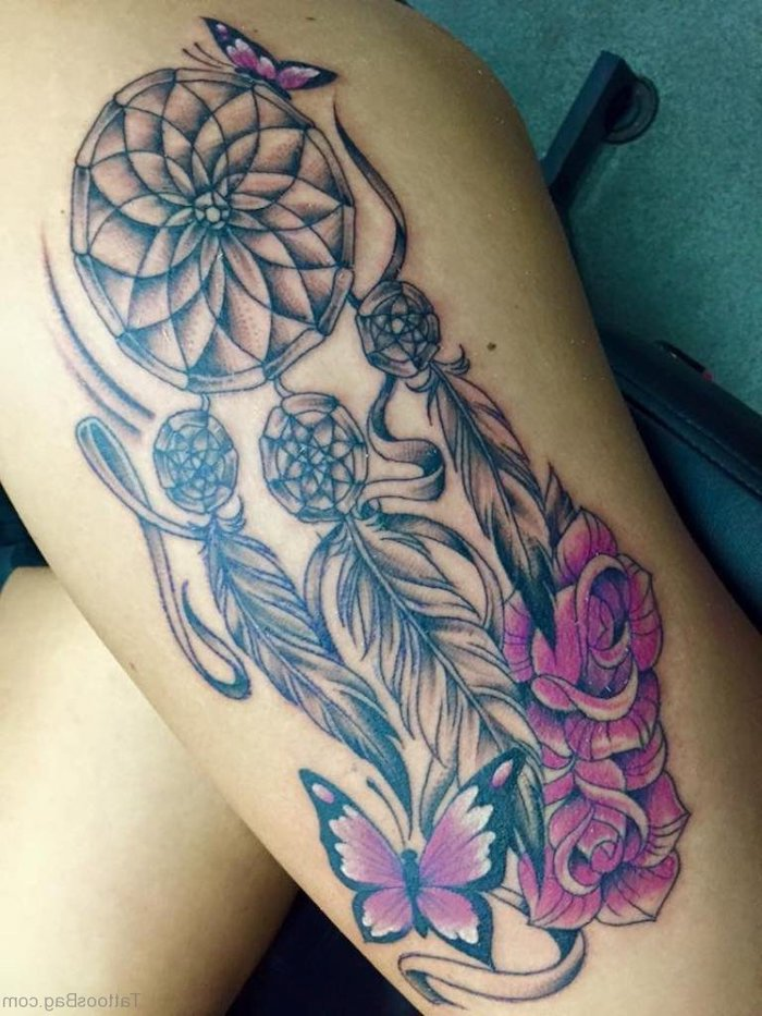 pink roses, pink butterflies, dream catcher tattoo on back, thigh tattoo