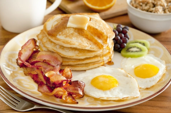 stack of pancakes, with butter and honey, fried eggs, bacon on the side, things to make for breakfast