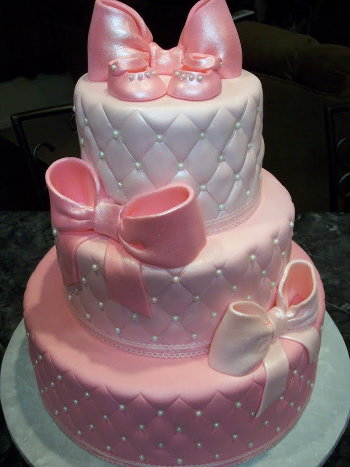 three tier cake, with pink and white fondant, pink bows, silver cake tray, minnie mouse baby shower