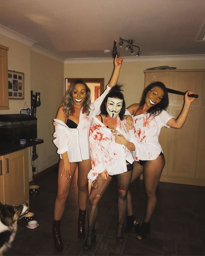 three women, dressed as characters from the purge, halloween costume ideas for men, wearing masks
