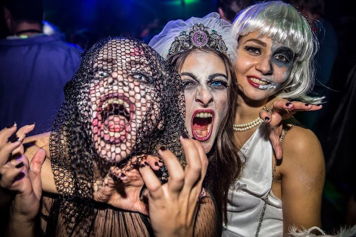 three women, posing for a picture, wearing scary make up, contact lenses, funny halloween costumes