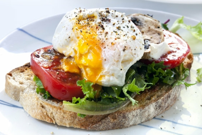 avocado toast, with green salad, things to make for breakfast, tomatoes and eggs, white plate