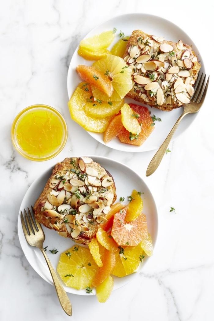 vegan brunch recipes, toast with nuts, orange and grapefruit slices on the side, orange juice