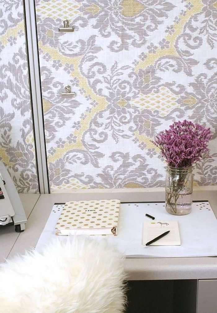 work desk decor, vintage wallpaper, purple flower bouquet, large notepad, white desk