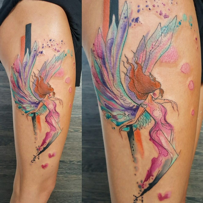 large thigh tattoo, watercolor angel wings tattoo, female angel with long ginger hair