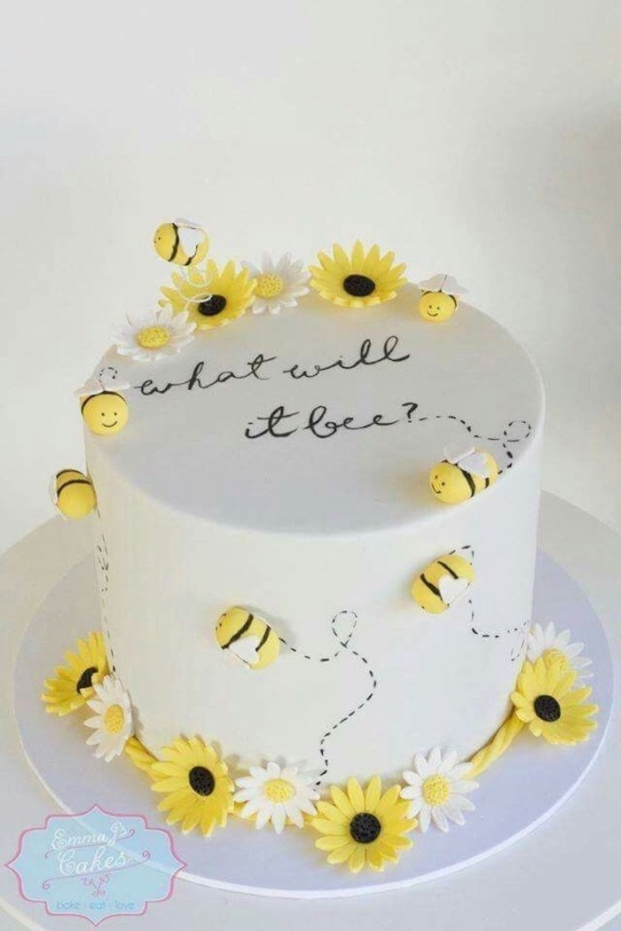 what will it bee, gender reveal smoke cannon, small cake, white frosting, yellow bees and sunflowers
