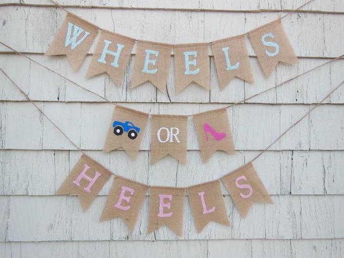 wheels or heels, large banner, gender reveal ideas pinterest, white wooden wall