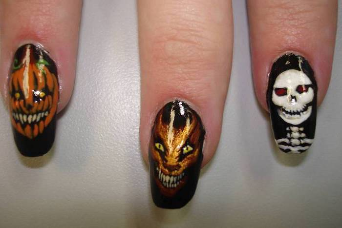 black nail polish, skeleton and monsters, orange decorations, squoval nails, orange ombre nails