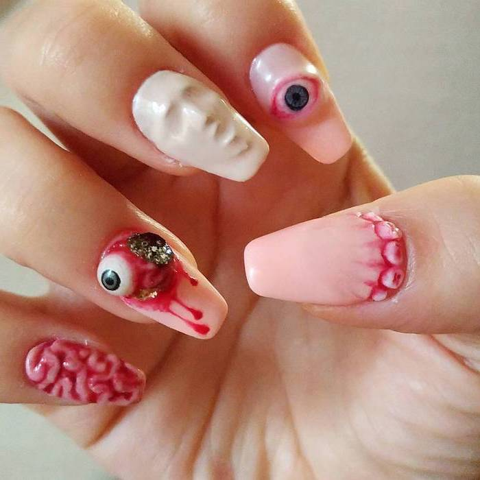 pink and white nail polish, orange ombre nails, squoval nails, eyes and brains, screaming face decorations