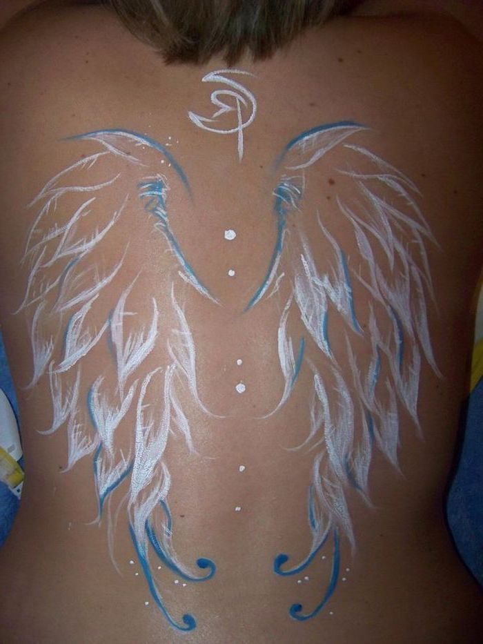 wings neck tattoo, white and blue colors, back tattoo, woman with brown hair