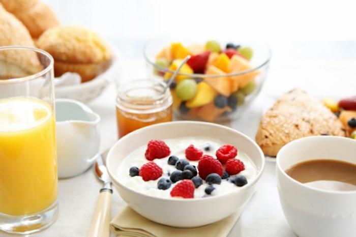 bowl of yoghurt, raspberries and blueberries, orange juice, vegan brunch recipes, fruit bowl