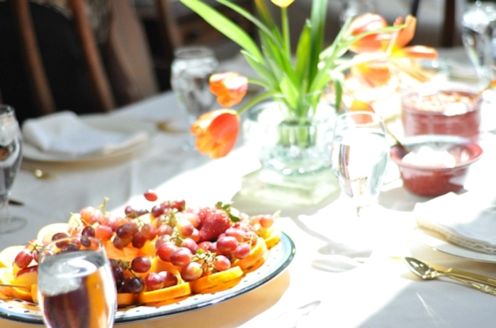 tulips bouquet, what to serve for brunch, fruit platter, orange and grapes, water glasses