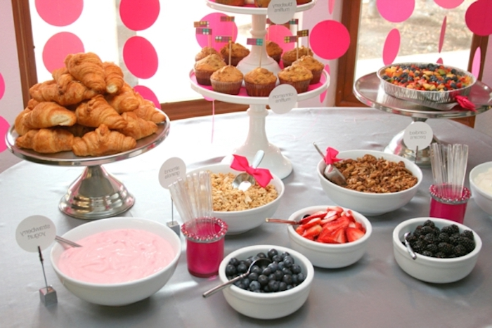 bowls of different fruits, breakfast finger foods, croissants, mini muffins, cake stands, brunch table
