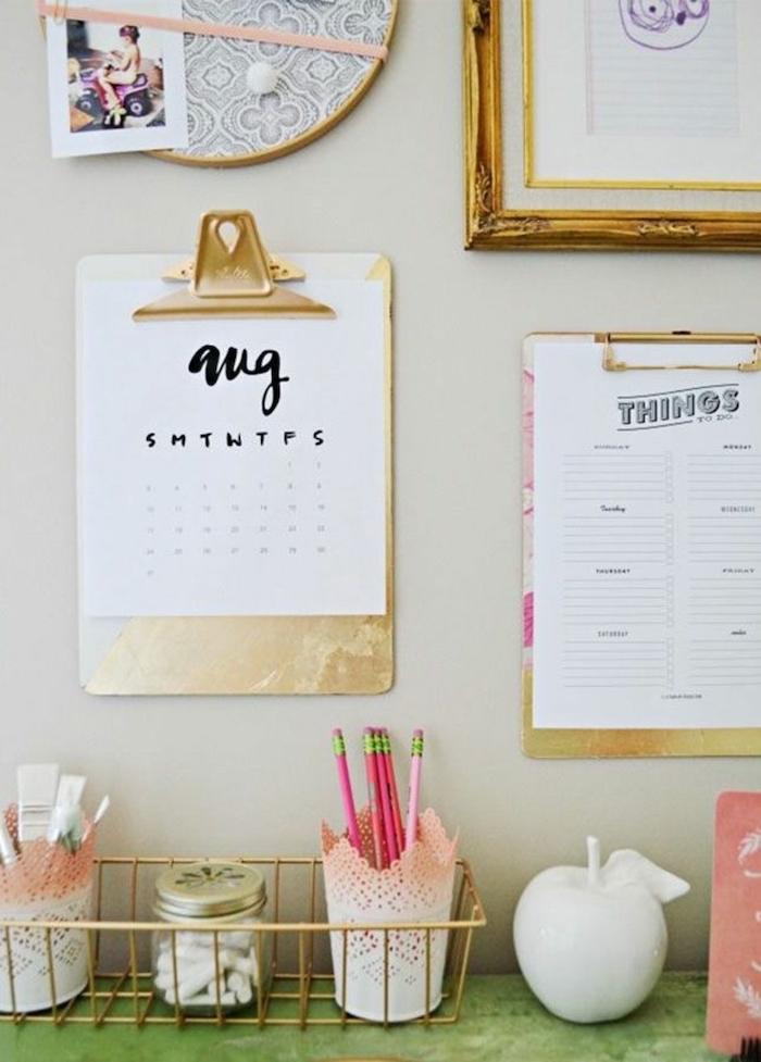 ideas for decorating your office at work, hanging folders, golden frame, golden basket, pencil holders
