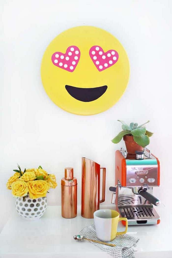 yellow emoji, hanging on white wall, coffee machine, yellow roses, flower bouquet, ideas for decorating your office at work