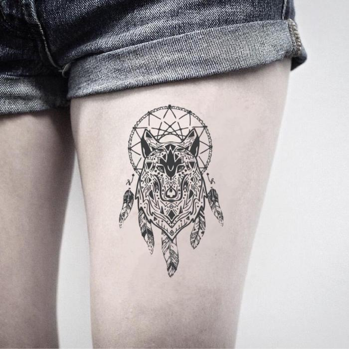 thigh tattoo, wolf tattoo, dream catcher tattoo ideas, white background, short jeans, dream catcher watercolor tattoo