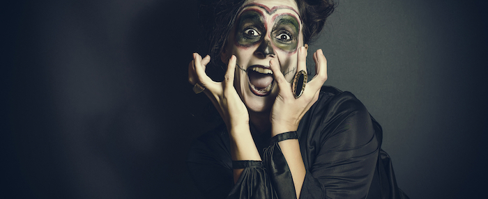 woman screaming, wearing scary make up, last minute halloween costumes, black silk dress, black background