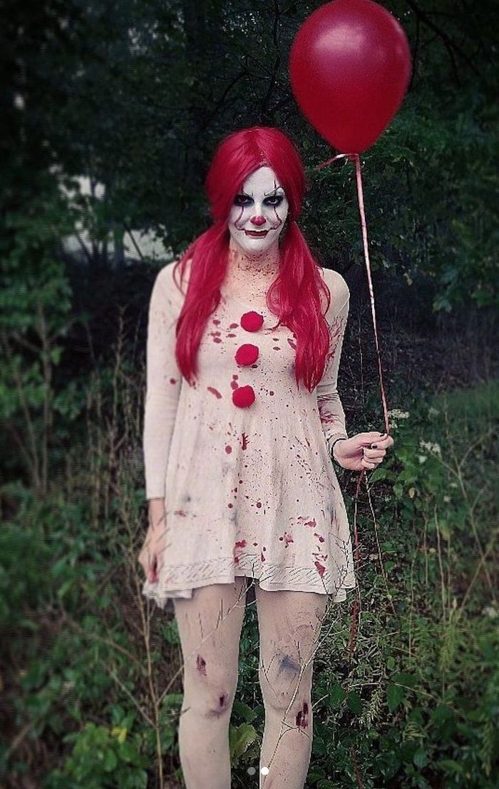 woman dressed as pennywise, holding a red balloon, easy halloween costumes for guys, red wig, clown make up