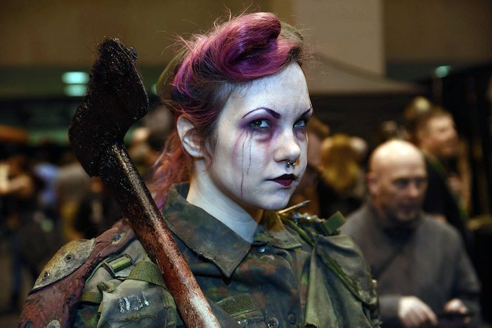 woman holding an axe, wearing a navy jacket, pink hair, face make up, easy halloween costumes for guys