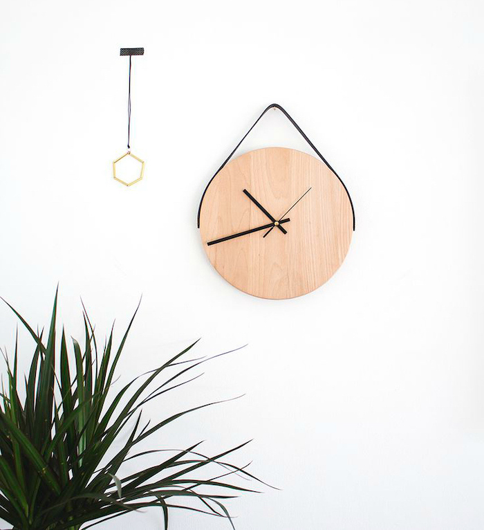 cubicle decor ideas, wooden clock, on a white wall, potted plant