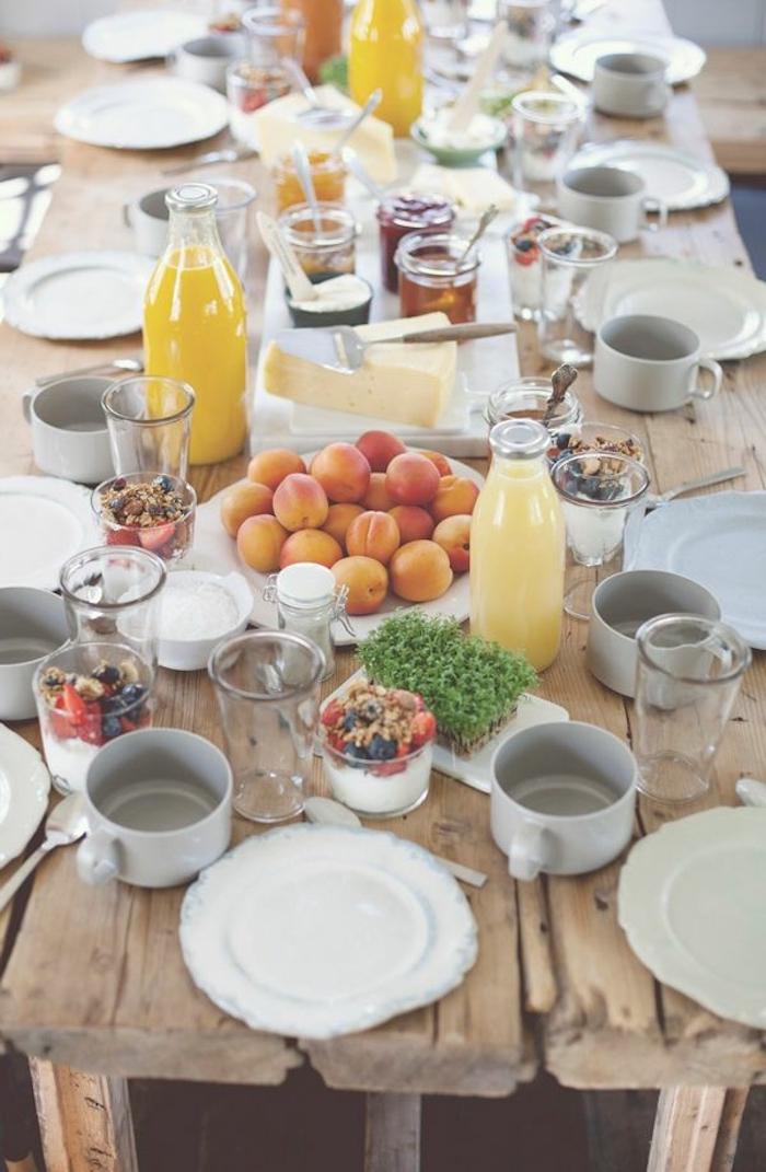 brunch table, orange juice, breakfast recipe ideas, fruit plate, yoghurt and granola in glasses, wooden table