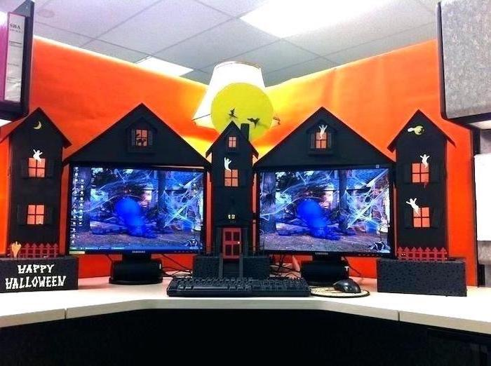 halloween decor, office cubicle accessories, two desktops, white desk, orange wallpaper, desk lamp
