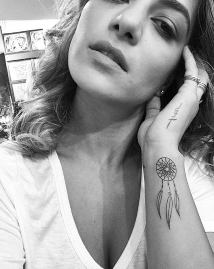 black and white photo, wrist tattoo, woman with white t shirt, dream catcher tattoo ideas
