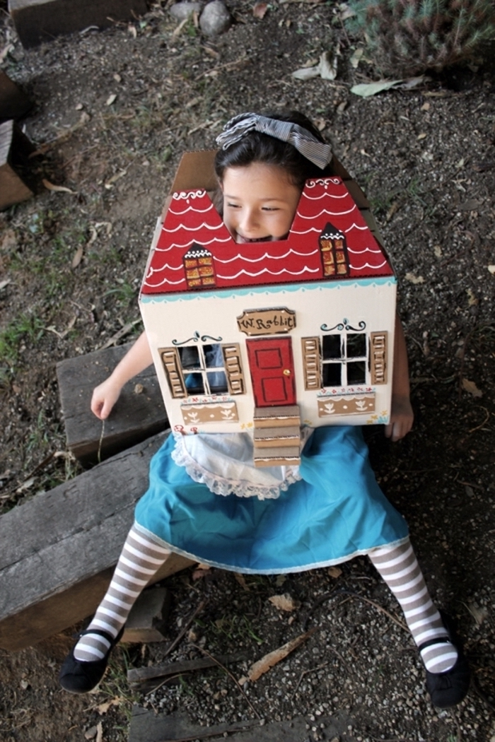 girl dressed as alice in wonderland, growing big, inside the house, halloween costume ideas, sitting on a wooden bench