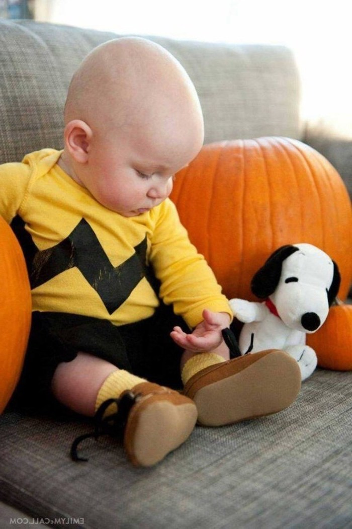 baby boy, dressed as charlie brown, surrounded by pumpkins, sitting on couch, dog plush toy, toddler girl halloween costume