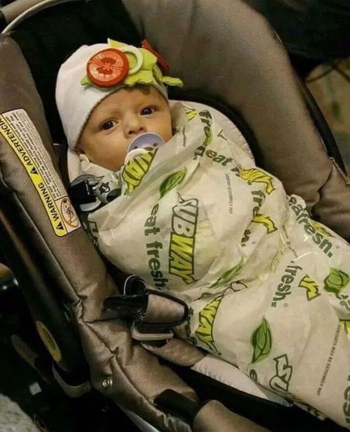 baby in a stroller, wrapped as a subway sandwich, white beanie, with vegetables, halloween costumes for kids girl
