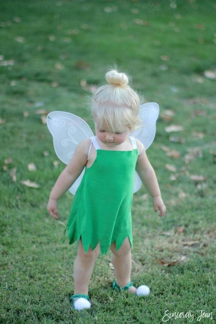 little girl, with blonde hair, dressed as tinkerbell, halloween costumes for kids girl, green dress, white wings