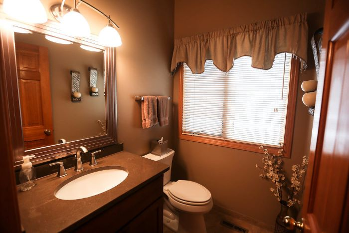 tips for your bathroom remodel, beige walls, square mirror, wooden vanity, small mirror, with blinds