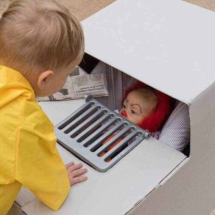 boy dressed as georgie, baby dressed as pennywise, inside a stroller, halloween costumes for kids girl, it movie inspired