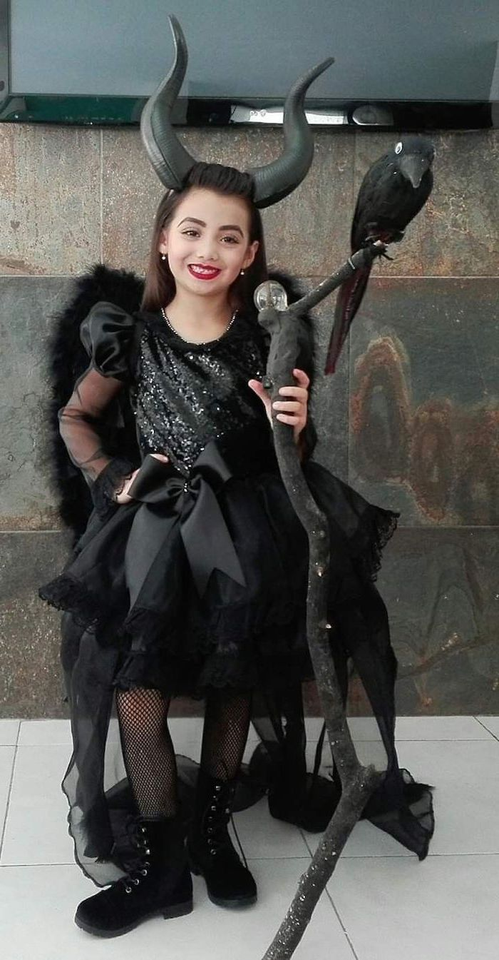 toddler halloween costumes, girl dressed as maleficent, black satin gown, with tulle and sequins