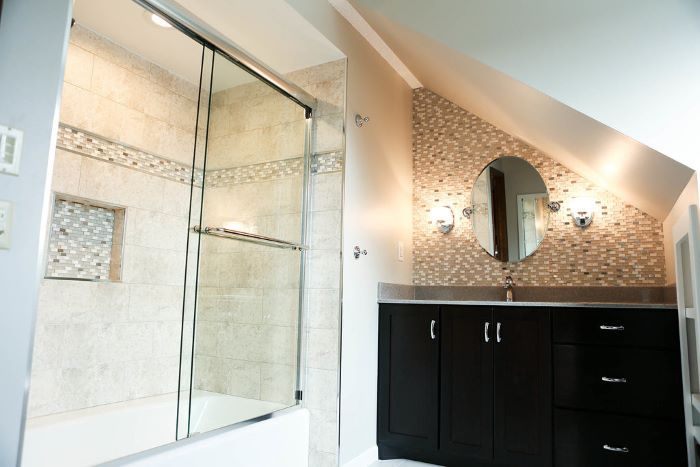 beige walls, mosaic accent wall, tips for your bathroom remodel, black vanity, shower cabin