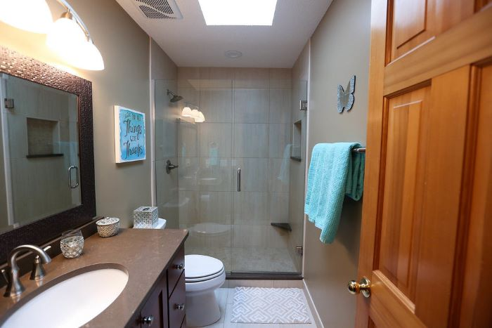 shower cabin, beige walls, square mirror, wooden vanity, tips for your bathroom remodel, blue towel
