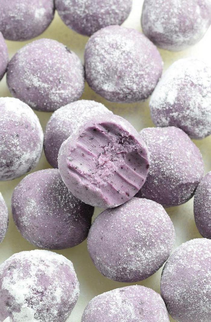 blueberry truffles, covered in powdered sugar, homemade desserts, half bitten off