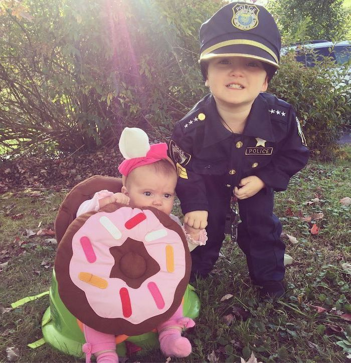 baby dressed as a donut, boy dressed as apolice officer, holding hands, halloween costumes for kids girl