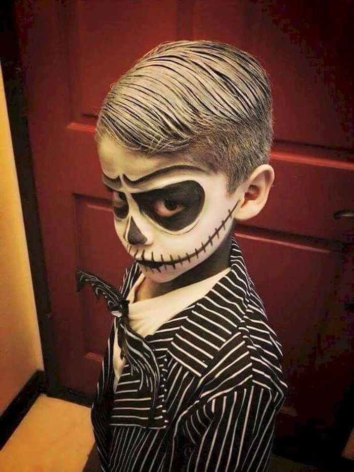 little boy, dressed as jack skellington, with face makeup, toddler halloween costumes, nightmare before christmas inspired