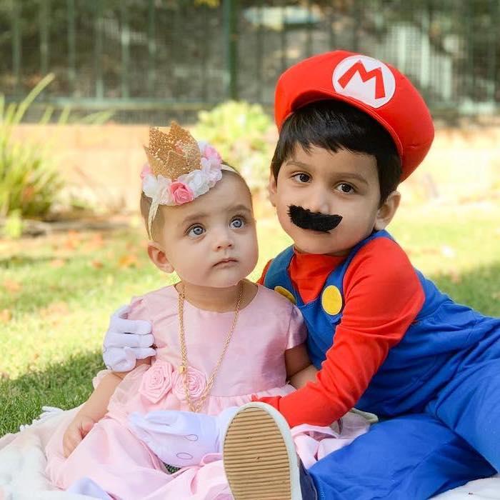 toddler boy costume, boy dressed as super mario, baby girl dressed as princess peach, pink dress