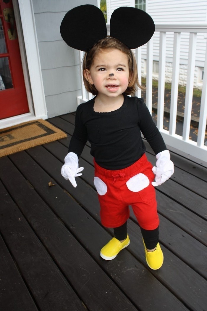 little boy, dressed as mickey mouse, yellow shoes, toddler halloween costumes, red pants, black mouse ears