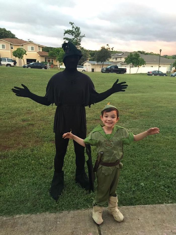 boy dressed as peter pan, man dressed as his shadow, toddler boy costume, standing on a grass field